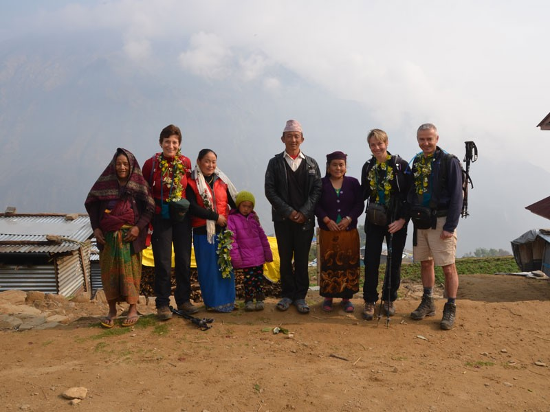 A photo with a group of local people